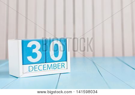 December 30th. Day 30 of month, calendar on wooden background. New year at work concept. Winter time. Empty space for text.