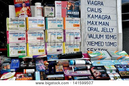 Bangkok Thailand - January 18 2014: Sexual enhancement products including Viagra Cialas oral jelly and condoms are sold by street vendors on Sukhamvit Road at Nana