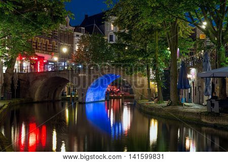 UTRECHT THE NETHERLANDS - JUNE 30: Illuminated Oudegracht canal on June 30 2016 in the centre of Utrecht The Netherlands