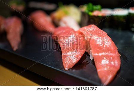 Maguro Sushi serve on Black plastic Tray