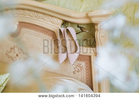 Beige Wedding shoes on the gatherings of the bride