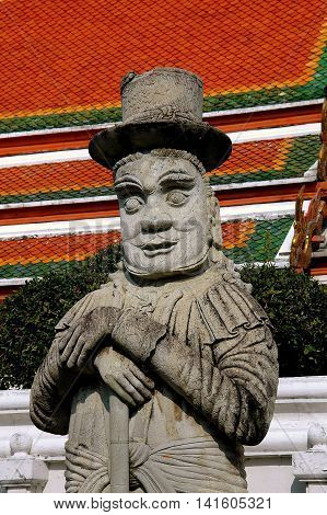 Bangkok Thailand - December 23 2005: Giant stone Marco Polo statue wearing a top hat in a courtyard at 16th century Wat Pho