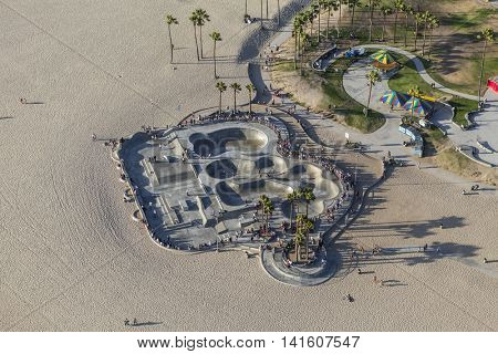 Los Angeles, California, USA - August 6, 2016:  Aerial view of summer beach goers at the popular Venice Beach Skateboard Park.