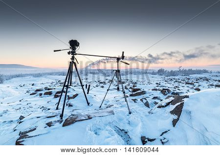 The Camera On The Two Tripods During Timelapse Shooting.