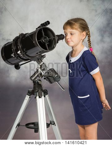 Girl Lover Of Astronomy With Interest Looks In The Eyepiece Of The Telescope