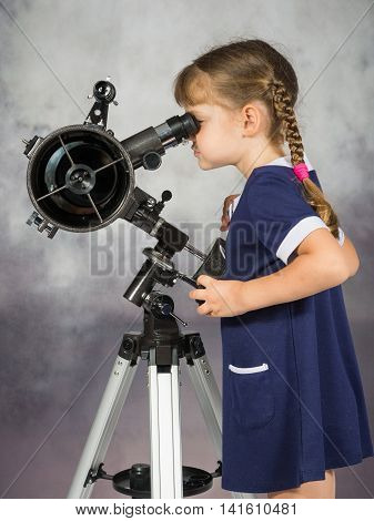 Girl Amateur Astronomers Looking Into The Telescope Eyepiece