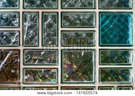 Semi-transparent clear and colour glass blocks construction retro style from the sixties image for background or architecture concept