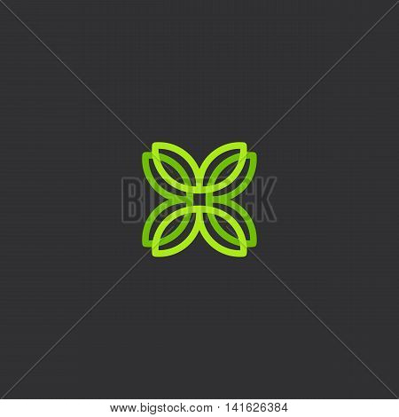 Isolated abstract green color flower petals vector logo on the black background. Cross logotype. Leaves illustration. Plant element. Natural products icon