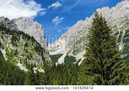 Mountain range high mountains Ellmauer Tor austrian travel destination Wilder Kaiser chain Tyrol.
