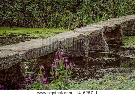 Stone bridge in pond at Nostell Priory England