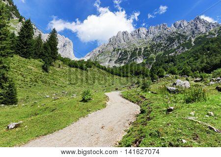 Mountain scene hiking in the Alps on a sunny day. Wilder Kaiser chain near Wochenbrunner AlmTyrol Austria.