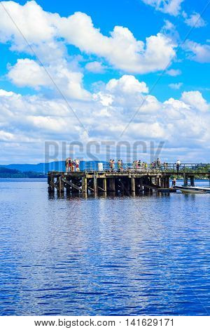 People having fun on a sunny day at the Luss Pier Loch Lomond Argylle and bute Scotland, 21 July 2016