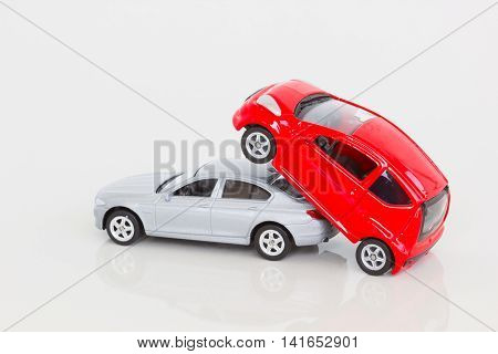 horizontal photo of two cars having sex in doggy style isolated on blank background