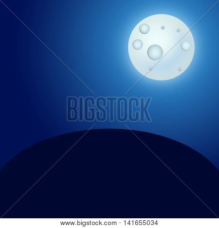 Full moon in the night sky over a glade