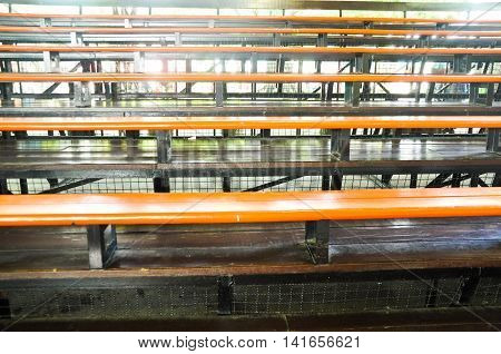 metallic bleachers in stadium, empty stadium in school