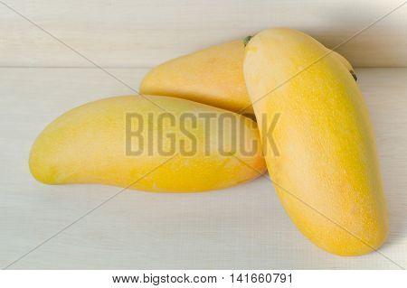 Mango Fruit Isolated On Wood Background