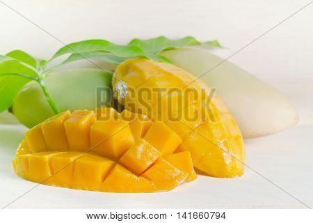 Mango Nicely Cut With Leaf On Wooden Background (also Known As Horse Mango, Mangifera Foetida, Anaca