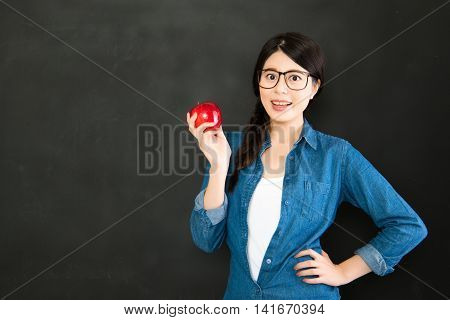 Happy Girl Student With Glasses And Apple From Blank Blackboard