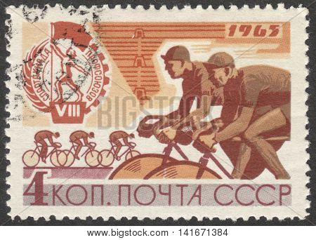 MOSCOW RUSSIA - CIRCA APRIL 2016: a post stamp printed in the USSR shows cycling the series