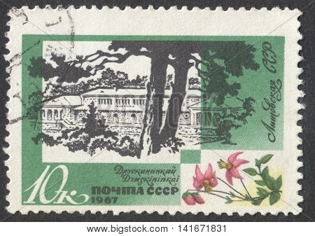 MOSCOW RUSSIA - CIRCA APRIL 2016: a post stamp printed in the USSR shows a view of Drusnininkai town Lithuania the series