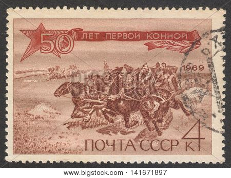 MOSCOW RUSSIA - CIRCA APRIL 2016: a post stamp printed in the USSR shows horses dedicated to the 50th Anniversary of First Cavalry Army circa 1969