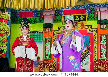 GEORGE TOWN MALAYSIA - MARCH 26: Actors playing traditional Chinese Opera on the street scene George Town Penang Malaysia on March 26 2016.