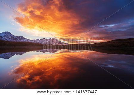 Mountain Lake. Beautiful sunrise. Morning landscape.  Koruldi Lake. Main Caucasian ridge. Zemo Svaneti, Georgia. Art processing of photos. Color toning