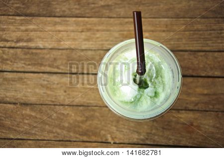 Green Tea Frappe on wood table, top view