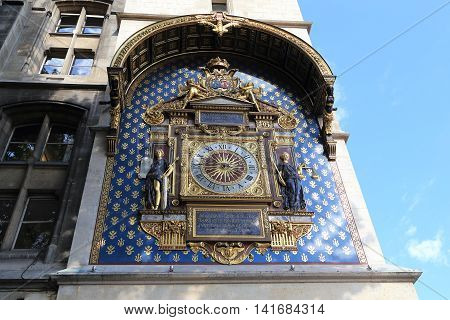 PARIS, FRANCE - MAY 13, 2015: This is 16th-century clock tower at the Conciergerie where in the 14th century the first city clock was uspanovleny.