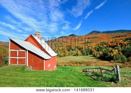 A farm house and Autumn foliage in New England
