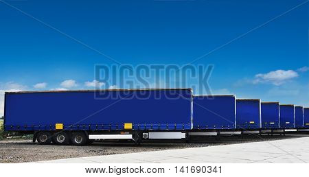 Truck semi trailers waiting to be unloaded at a warehouse or factory