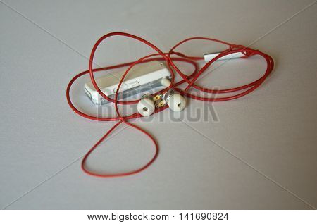 MP3 Player connected red headphones, ear phone