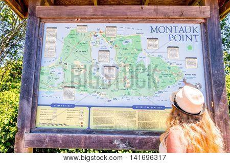 MONTAUK, LONG ISLAND, US, JUNE 18, 2016: Tourist studies map of Montauk region