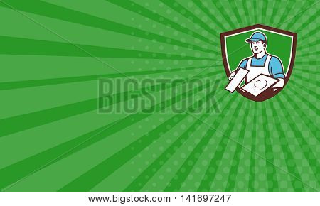Business card showing illustration of a plasterer masonry tradesman construction worker wearing hat holding trowel viewed from front set inside shield crest done in retro style on green sunburst background.