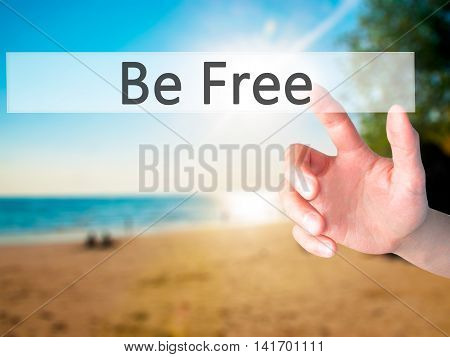 Be Free - Hand Pressing A Button On Blurred Background Concept On Visual Screen.
