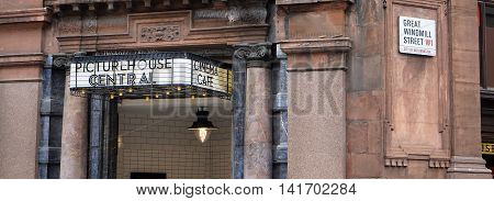 LONDON, UK - JULY 25: The 20th-century styling of the traditional entrance sign of the London's Picturehouse Central arthouse cinema contrasts with the historic columned facade of the building in which it is housed on July 25, 2016.