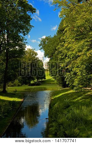 Poland-Warsaw,July 2016:The view from the bridge over the snap ring groove the park in the distance Museum Lazienki Royal Park in Warsaw July 2016.Editorial.Vertical view.