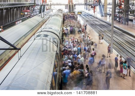 Madrid Spain - July 11 2016: Commuters at Atocha Train Station platforms. Slow motion shot on July 11 2016 Madrid Spain