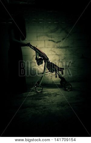 Ghost woman with baby stroller in Haunted House,Scary background for book cover