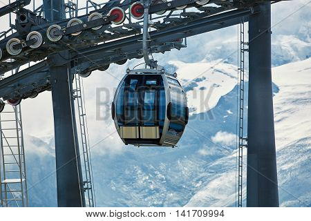 trailer lift in the mountains on snow background