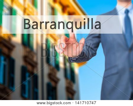 Barranquilla - Businessman Hand Pressing Button On Touch Screen Interface.