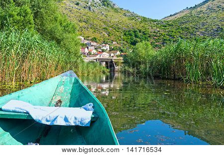 The punt boat is the best way to discover the Moraca River enjoy its beauty and landmarks Vranjina Montenegro.