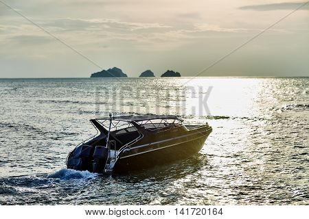Boat on sunset in the sea. Vacation background