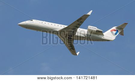 Moscow region - 31 July 2016: passenger plane Bombardier CRJ-200LR Severstal Airlines flies to Moscow's Domodedovo airport July 31 2016 Moscow Region Russia