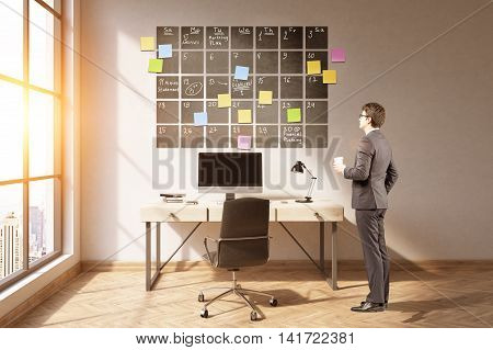 Office interior. Businessman standing in office looking at large calendar on wall. Concept of good schedule. 3d rendering. Toned image. Mock up