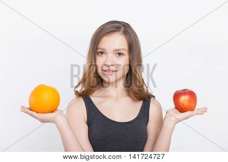 Girl With Red Apple And Orange