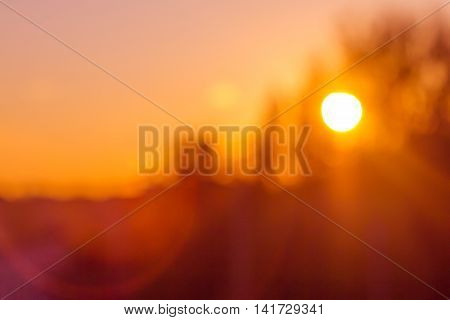 Blurred sunset background in bright orange colors