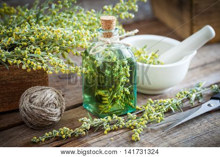 Bottle Of Absent Or Tincture Of Tarragon Healthy Herbs, Absinthe Healing Herbs, Scissors And Mortar.
