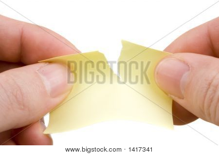 Tearing yellow paper - on a white background poster