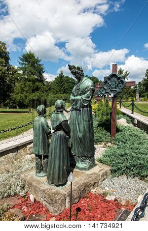 Debowiec Poland - July 20 2016: Statue of Virgin Mary weeping next to the Basilica of Our Lady of La Salette in Debowiec in Poland